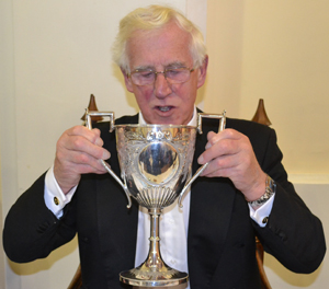 Adrian Gifford taking a rather large gulp of Port from the 'Loving Cup'.