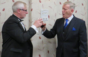 Pictured are: Jon Davies WM being toasted by Roger Lloyd-Jones during the masters song.