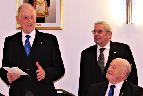 Barry responding to his toast watched by Phillip Holland (seated) and Terry Howard.