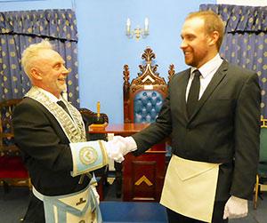 Stephen Robinson congratulates Harry Robinson.