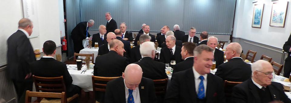 Diners enjoying a sumptuous menu.