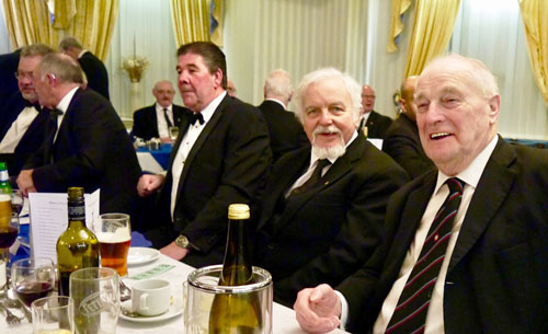 Guests enjoying the festive board and a small amount of wine.