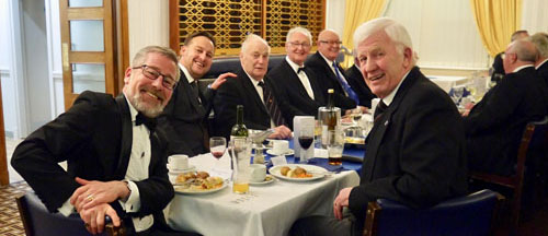 Senior warden Bob Marsden (left) and his guests enjoying the festive board.