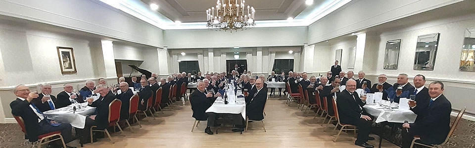 All the brethren raising a glass to the new WM.