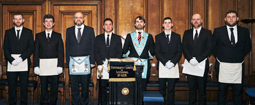 A regular meeting of the lodge: WM with a recent initiate, five new initiates and one joining member.