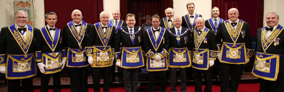 Kevin Poynton and David (centre) surrounded by the senior brethren present.