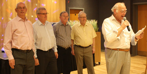 Dividing the proceeds. Pictured from left to right, are: David Whitmore, John Selley, Peter Kelly, Ernest Lloyd and David Ogden.