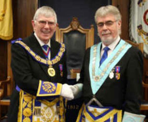 Tony (left) congratulates the new WM of the Lodge of Unanimity Howard Linaker.