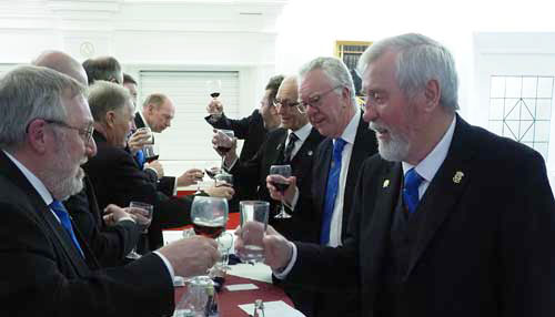 Norman Prue (right) toasts health with Derek Lewthwaite, with other brothers joining in.