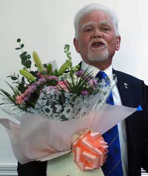 David Randerson receives flowers for his wife Anne.