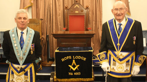 Elder statesman Ted Pierce (right) proudly guards the new lodge cushion with WM John Lomax.