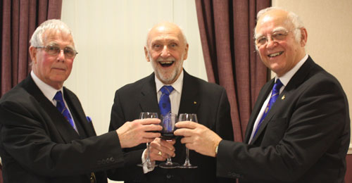 Delighted with his new promotion, Peter Halliwell (centre) enjoys a congratulatory toast with David Ogden (right) and Geoffrey Porter.