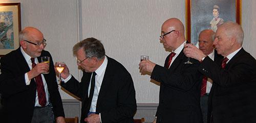 John James (left) taking wine with the three principals.