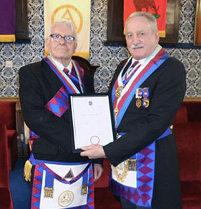 David receiving his jubilee certificate from Sam Robinson.