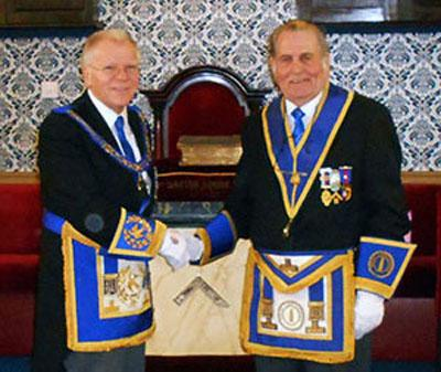 Derek Parkinson congratulating David Jones.