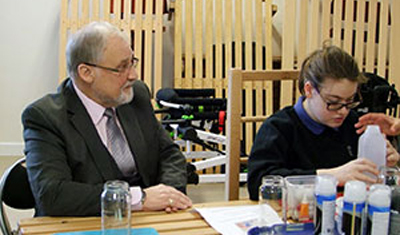 Eric O'Callaghan with one of the pupils at Stick 'n' Step.