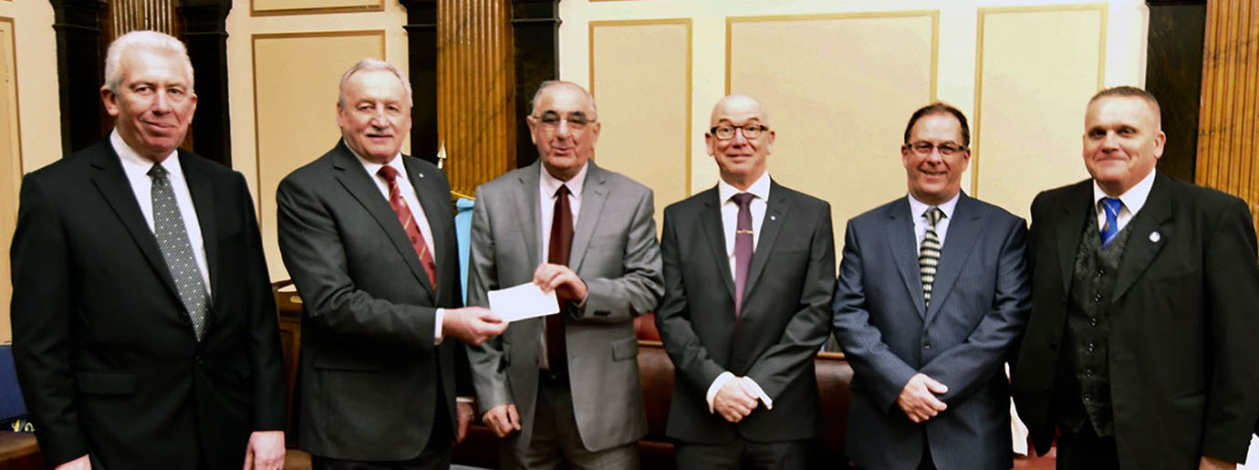Pictured from left to right, are: Mark Matthews and Sam Robinson presenting a cheque to Joe Stalled, with golfers Phil Pattulo, Tommy Walsh and Geoff Brown.