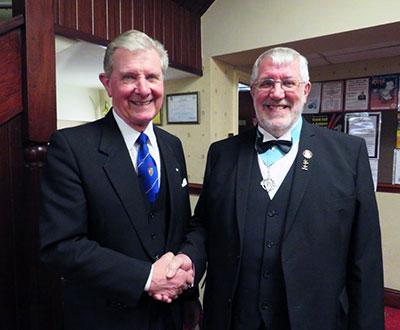 Stuart Thornber (left) congratulates the new master Brian Crawford.