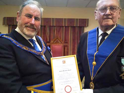 Frank Umbers (left) presenting David Magill with his jubilee certificate.