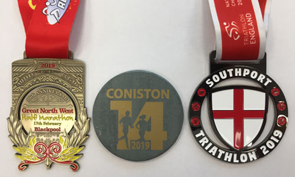 Peter's medals from his three gruelling events.
