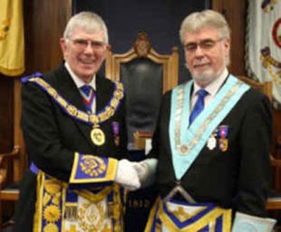Tony (left) congratulates the new WM of the Lodge of Unanimity Howard Linaker.