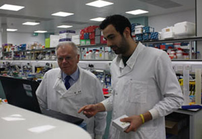 Michele (right) explains to Derek how results are stored and analysed.