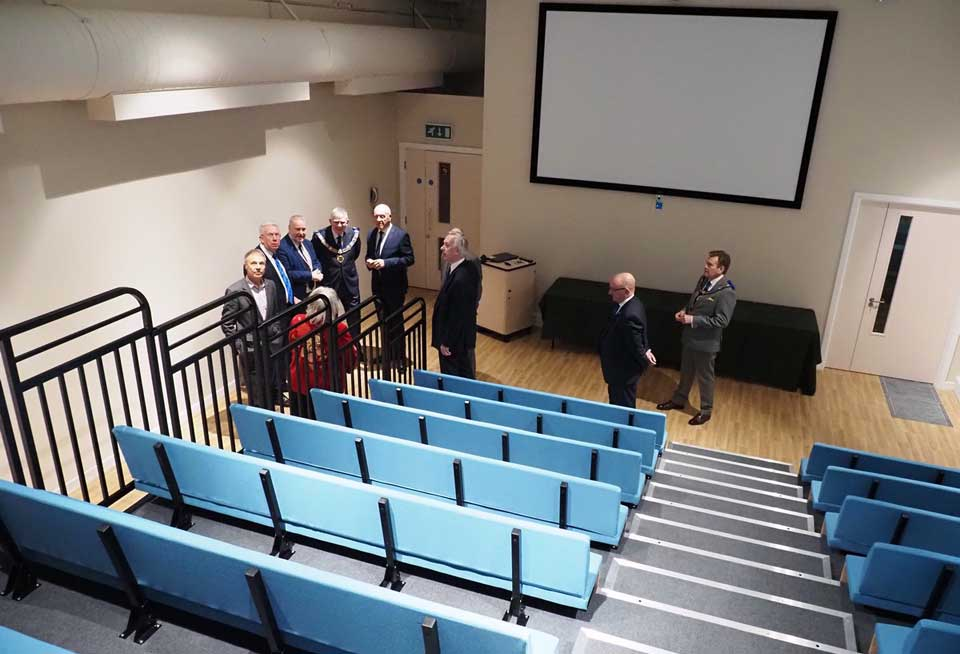 The team are pictured in the theatre, which is about to undergo modernisation and expansion.