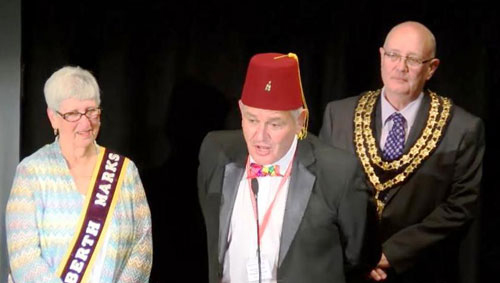 Ian (centre), with the Mayor of Ulverston (right) and the curator of the Laurel and Hardy Museum from the USA looking on.
