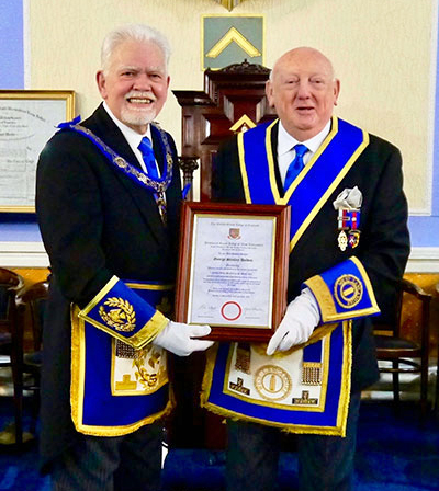 David Randerson (left) and George Holden with his commemorative certificate.