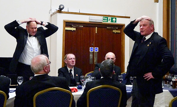 Brethren playing the game 'heads or tails' to win a bottle of whiskey.