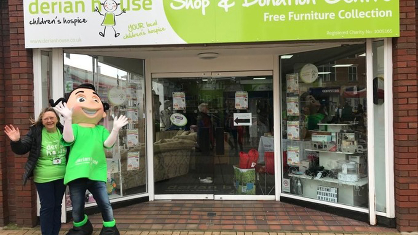 The shop, picture taken on the first anniversary of its opening earlier this year, with volunteer Julie Nolan and Derian House mascot Danni.