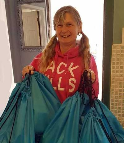 Paula McKee with bags to deliver.