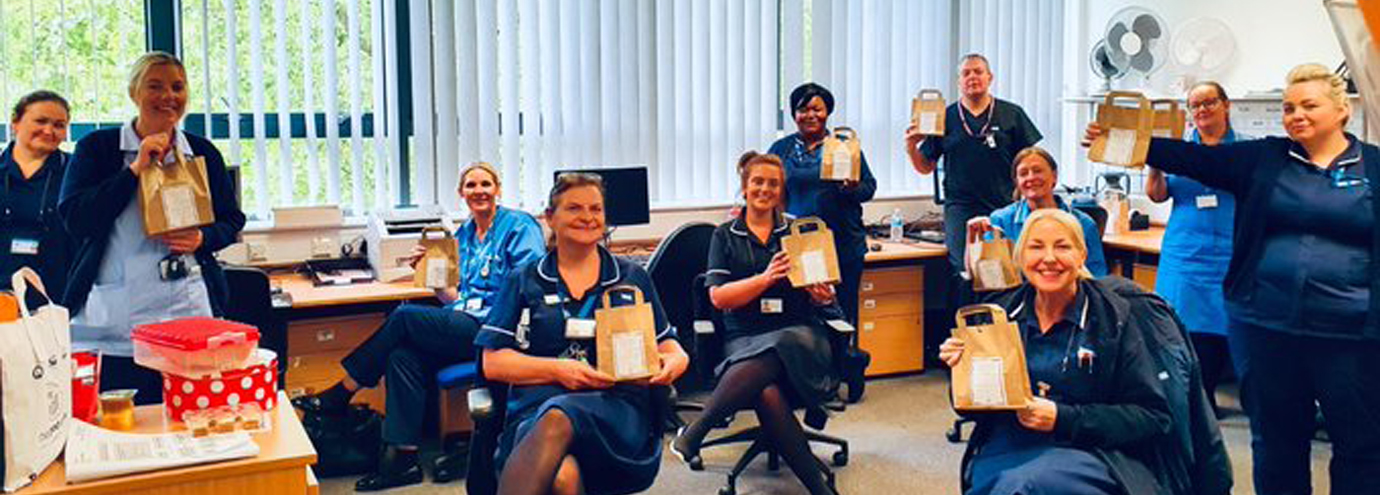 The staff at Mersey Care in Litherland gather round to say thank you for their treats.