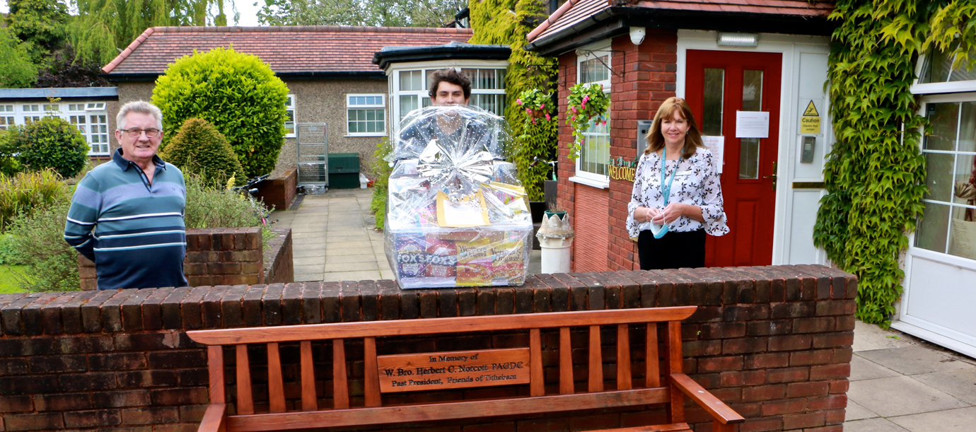 The Tithebarn activity hamper. Pictured from left to right, are: Joe Williams, Jake Huggett and manager Linda Johnson (with Ron Elliot taking the picture!).