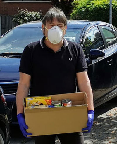 Glen collecting food items from brethren to take to the foodbank.