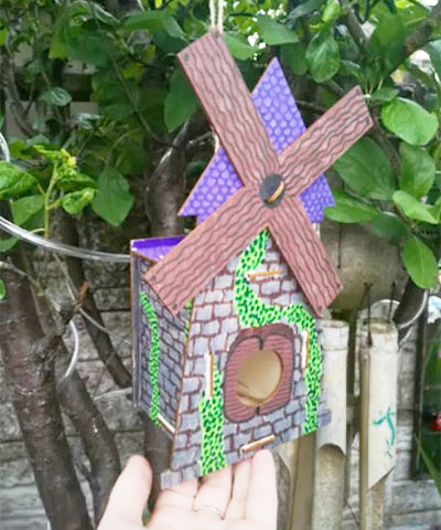 A decorated bird house from the week one activity competition.