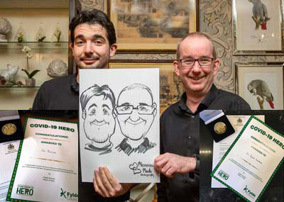 Jon Boriss (left) and Jon Hardman with a cartoon of themselves and their awards inset.