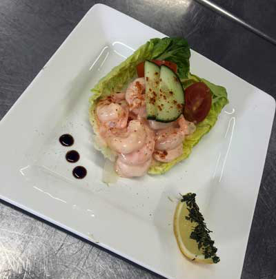 A prawn cocktail starter presented on a new and modern Palace plate.