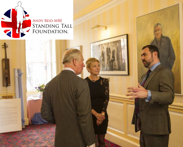 Andy talking to HRH Prince Charles with Standing Tall Foundation logo inset