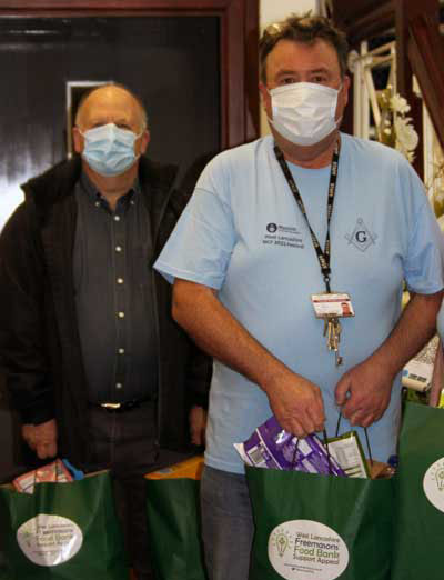 John Nicholls (right) with Robert Bentwood with donations at St Annes.