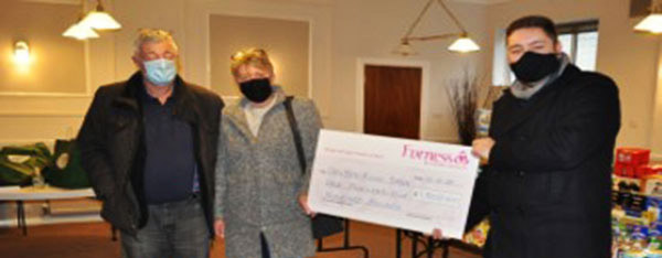 Dalton Food Bank representatives David and Tracy Taylor receive their cheque from Robert Jukes (right).