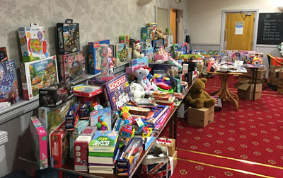 A collection of Christmas toys at Bryn Masonic Hall ready for delivery.
