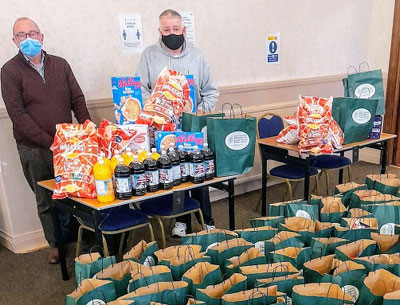 Widnes Group Chairman Neil Pedder and Widnes Group Charity Steward Bob Williams getting parcels ready for delivery.