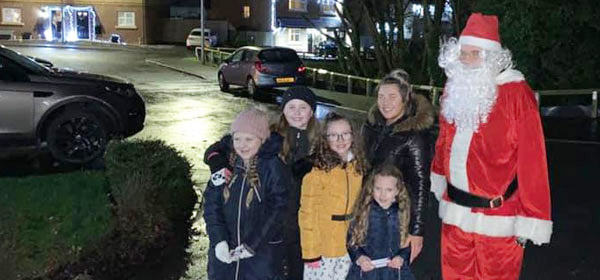One family surprised and delighted with Santa.