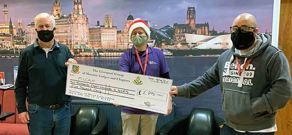 Dave Johnson (left) presenting the first cheque to representatives of MICAH.