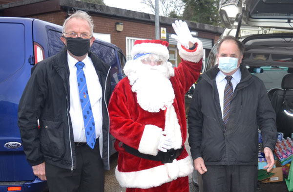 Pictured: from left to right are: Derek Midgley, Father Christmas (Don Carton) and Graham Chambers.