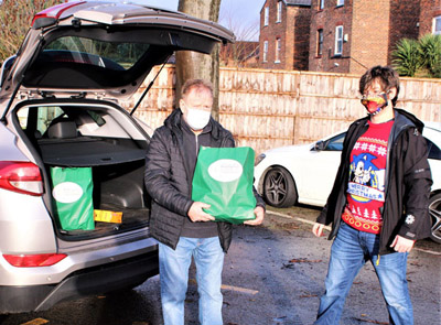 Hand and Heart Lodge No 4109 WM Steve Masters (left) and Alex Wood loading up the first delivery.