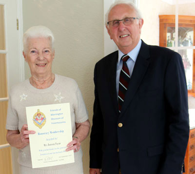 Vic presenting Doreen with her Commemorative Certificate