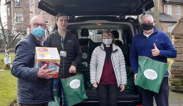 Pictured from left to right, are: Neil Pedder, Chris Farley, Rev Linda Riley-Dawkin and Bob Williams unloading food parcels.