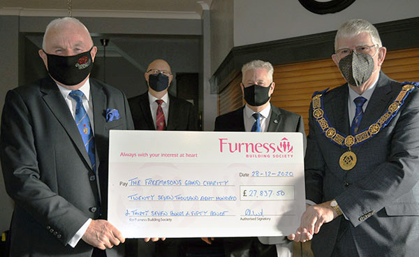 Pictured from left to right, are; Richard Wilcock, Gary Rogerson, Peter Schofield and the Provincial Grand Master Tony Harrison. The cheque was presented by the group charity steward Richard Wilcock and represents the total of matched funding assistance within the Furness and South Lakeland Group towards their individual patronage of the 2021 Festival.